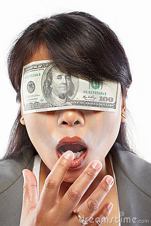 Businesswoman being blinded with money
