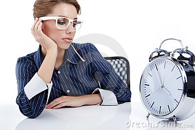 Businesswoman with a big clock