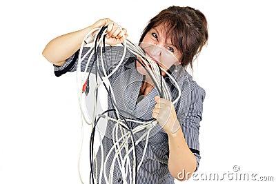 Businesswoman biting wires