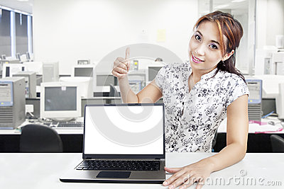 Businesswoman with blank laptop monitor