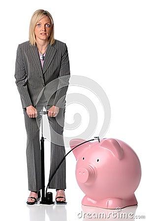 Businesswoman Blowing Up Piggy Bank