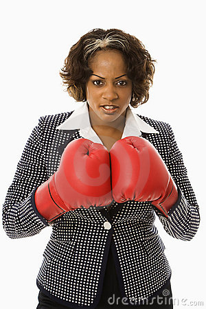 Businesswoman in boxing gloves.