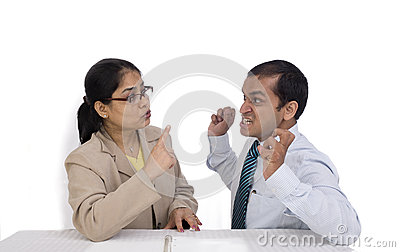 A businesswoman and a businessman talking aggressi