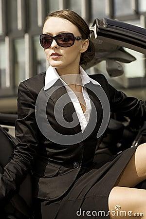 Businesswoman in a cabrio