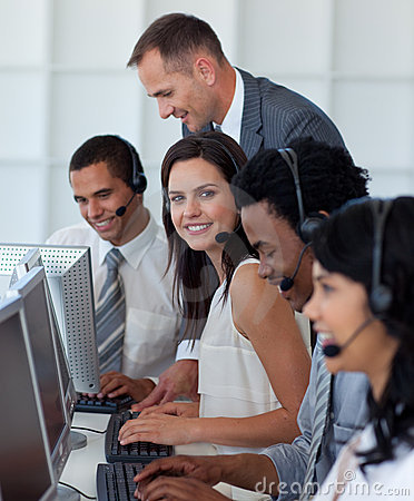 Businesswoman in a call center with her team