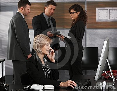 Businesswoman calling in office
