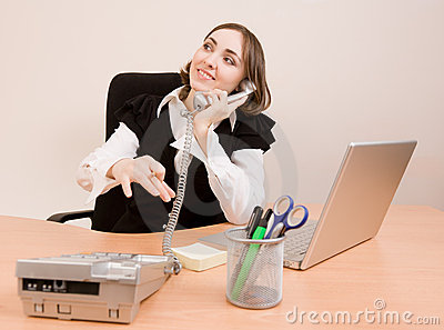 Businesswoman calling to phone
