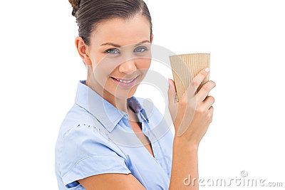 Businesswoman carrying coffee cup
