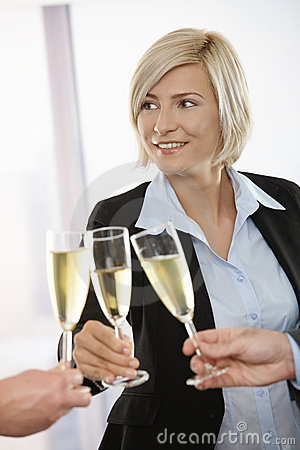Businesswoman celebrating with champagne