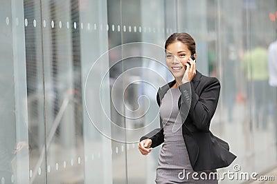 Businesswoman on cellphone running
