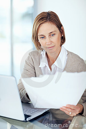 Businesswoman checking the documents at office