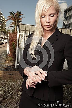 Businesswoman checking her watch
