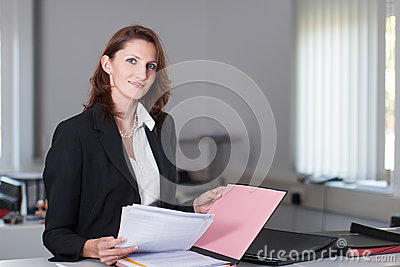 Businesswoman checks documents