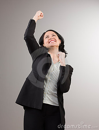 Businesswoman cheering and celebrating her success