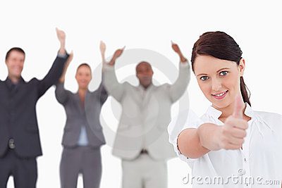 Businesswoman with cheering colleagues