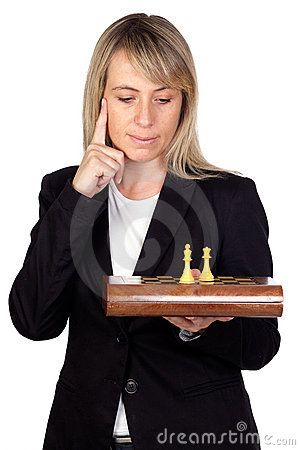 Businesswoman with chessboard