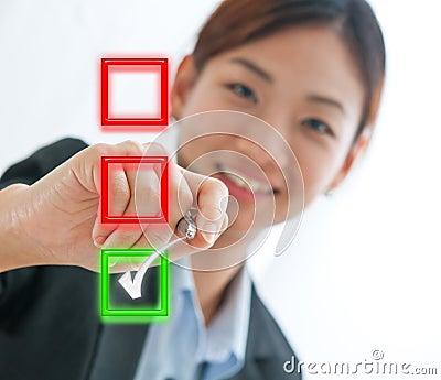 Businesswoman choosing mark the check box