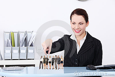 Businesswoman choosing worker.