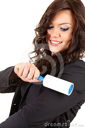 Businesswoman cleaning dust with lint roller