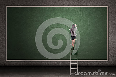 Businesswoman climbing ladder