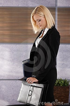 Businesswoman closing briefcase