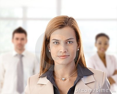 Businesswoman and colleagues in office