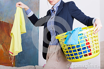 Businesswoman collecting dirty clothes