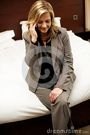 Businesswoman communicating with her husband