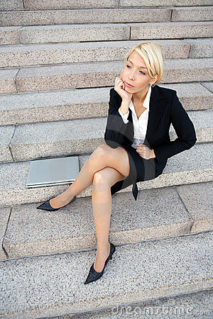 Businesswoman contemplating