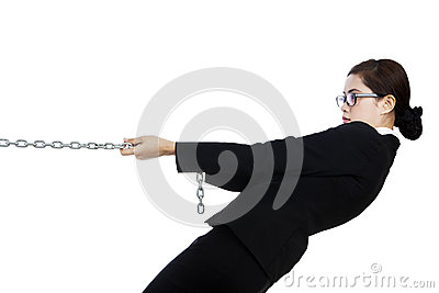 Businesswoman in control isolated in white