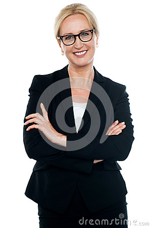 Businesswoman with crossed arms wearing glasses