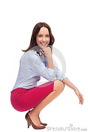 Businesswoman crouching