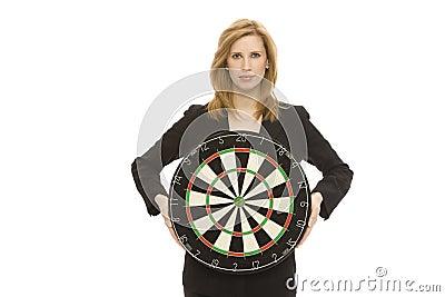 Businesswoman with dart board