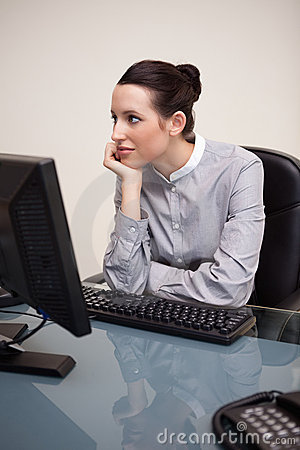 Businesswoman daydreaming at workplace
