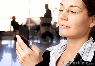 Businesswoman dials cellphone