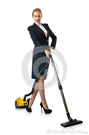 Businesswoman doing vacuum cleaning
