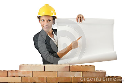 Businesswoman with drawings near  wall