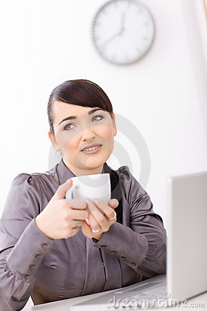 Businesswoman drinking coffe