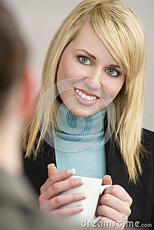 Businesswoman Drinking Tea or Coffee