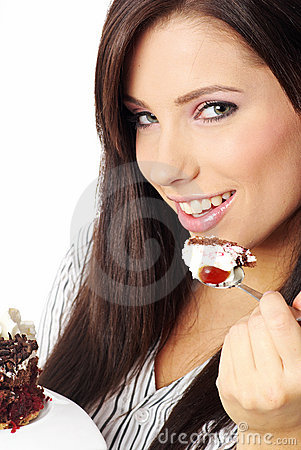 Businesswoman  eating the cake.