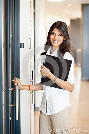 Businesswoman entering office