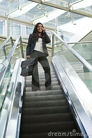Businesswoman on an Escalator