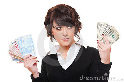 Businesswoman with euro and dollar money notes
