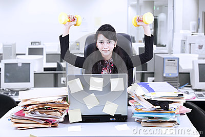 Businesswoman exercise in office