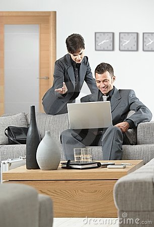 Businesswoman explaning to businessman