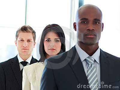 Businesswoman in focus with her team in a line