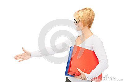 Businesswoman with folders ready for handshake
