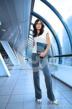 Businesswoman in futuristic interior