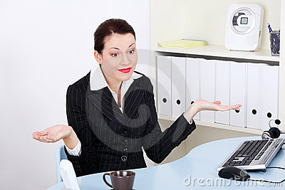 Businesswoman gesturing don`t know what to do.