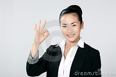 Businesswoman gesturing OK